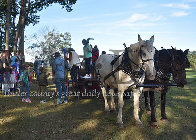 Crowds lined up for horse-drawn hayrides from during Saturday's Oktoberfest at Concordia Lutheran Ministries in Cabot. Hundreds came out for annual event that featured a German band, German-themed food, pumpkin painting and other children's activities. ANDIE HANNON/BUTLER EAGLE