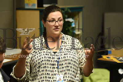 Kate Eberle Cotter leads a group session of Reach and Rise at the Butler YMCA. Seb Foltz/Butler Eagle