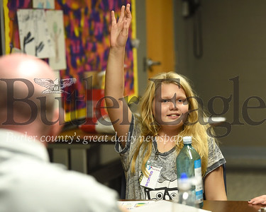 Breonah Johnston raises her hand to answer a question during a session of the Reach and Rise program at the Butler YMCA. Seb Foltz/Butler Eagle
