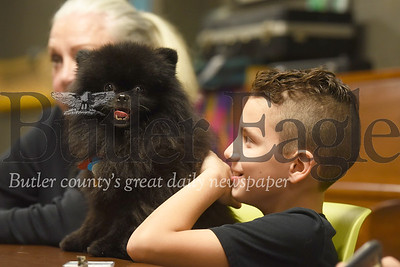 Sebastian Wise follows along during a Reach and Rise lesson with Smokey the therapy dog. Seb Foltz/Butler Eagle
