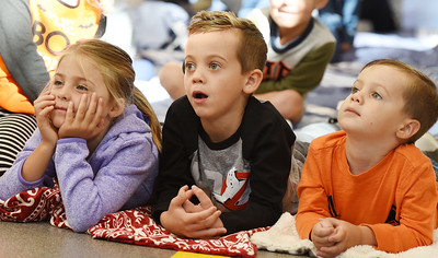 Harold Aughton/Butler Eagle: (Left – Right) Avery Cooper, 6, along with Jackson, 6, and Grayson, 3, Herbanek listen intently to Adams Twp. Fire Chief Tim Llewellyn Tues during Mars Area Public Library story time held at the Adams Fire Station, Tues. Oct. 8.