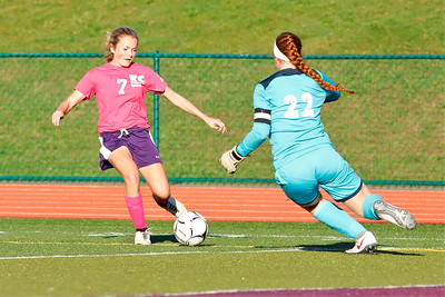 Karns City #7 attempts a move past Slippery Rock goalie. Seb Foltz/Butler Eagle
