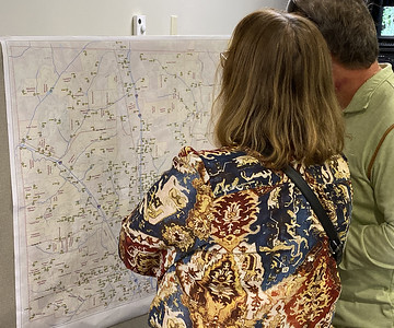 Photo by J.W. Johnson Jr.Residents look at a stormwater system map Wednesday during an open house on a proposed stormwater management program in Cranberry Township.