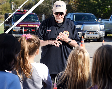 Harold Aughton/Butler Eagle: Cranberry Volunteer Fireman, Mark Schall, explains the importance of knowing your address and phone number to third graders in Miss King's class at Rowan Elementary, Wed., Oct. 9.