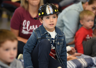 Harold Aughton/Butler Eagle: Collin Bebb, 4, of Admas Twp. sportted his fireman's hat to the story time reading held by the Mars Library at the Adams Fire Station, Tues., Oct. 8.