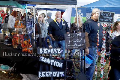 Zelienople Fall Fest attendees peruse booths Saturday. 2019. Seb Foltz/Butler Eagle
