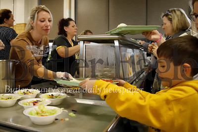 Butler Catholic School teacher Shauna Hohn serves up lunch to student John Fouse during the school's 50th anniversary celebration Saturday. Alumni, former employees, current staff and students came together Saturday for a full day of activities at the school. Seb Foltz/Butler Eagle