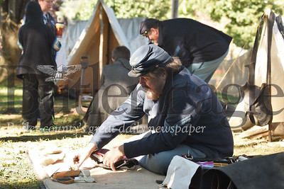 Clad in Union Soldier garb, Ed Boots of Fombell displays a Civil War era soldier's belongings at a simulated Union camp at Zelienople Fall Festival. Seb Foltz/Butler Eagle 2019
