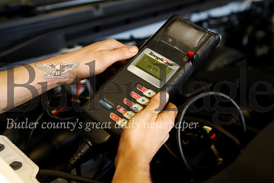 Baglier Buick GMC technician Hunter Romito tests a car battery. Seb Foltz/Butler Eagle