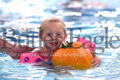 Ella Demitras, 4, swims with her pumpkin at the Butler YMCA's Floating Pumpkin Patch event Saturday. Seb Foltz/Butler Eagle