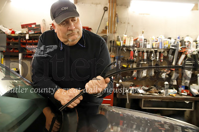 Jim Davidson of Jim Davidson's Auto Repair replaces windshield wipers on a Subaru in his shop. Seb Foltz/Butler Eagle