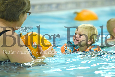 Deklan Timblin, 2, swims toward Lorie Goss and his pumpkin at the Butler YMCA Satudurday during their annual Floating Pumpkin Patch event Saturday. Seb Foltz/Butler Eagle