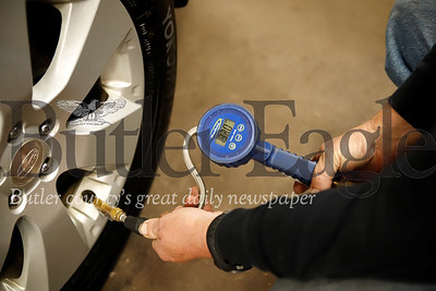 Jim Davidson of Jim Davidson's Auto Repair checks the tire pressure on a Subaru in his shop. Seb Foltz/Butler Eagle