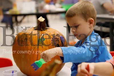 Grady Demitras, 4, paints his pumpkin at the Butler YMCA's Floating Pumpkin Patch event Saturday. Seb Foltz/Butler Eagle