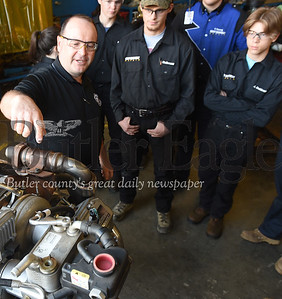 Harold Aughton/Butler Eagle: Bill Rearick, instructor in the Butler Vo-Tech Heavy Equipment Technology program, explains the benefits of the new disel engine donated by the Butler County Motor Company.