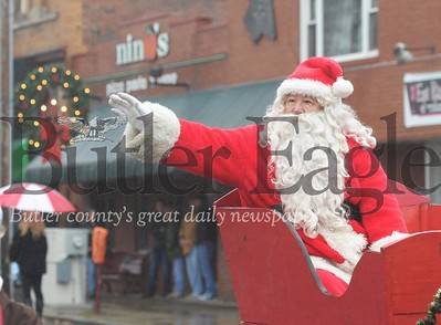 Santa Claus's arrival is mark by the annual Zelienople Christmas parade on Saturday, November 28, 2015. (Tye Cypher for the Butler Eagle)
