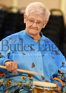 Harold Aughton/Butler Eagle: Myra Davidson, 89, of Mars joined the drum circle at the senior center in Evans City, Wed., Oct. 16.