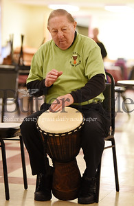 Harold Aughton/Butler Eagle: Ron Rishack, 81, joined the drum circle at the Evans City Senior Center, Wed. Oct. 16.