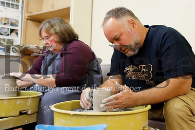 Shirley McCauley and David Buccieri work on a potter's wheel projects during an open studio session at the Butler Art Center on Main St. in Butler Thursday evening. Seb Foltz/Butler Eagle