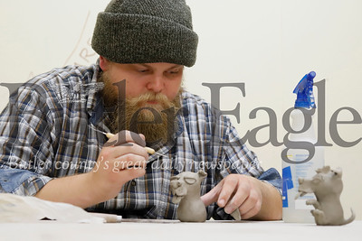 Butler Art Center ceramics studio director Clayton Smith works on a ceramic sculpture during an open studio session at the art center on Main St. in Butler Thursday.  Starting this month, Smith will host open studio time at the center Wednesday through Friday from 4 to 9 p.m. The program is one of a number of art offerings from the organization. For a monthly fee participants can have access to the studio three nights a week. The center also offers courses and other programing. Seb Foltz/Butler