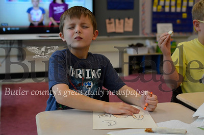 Lennon Grossbauer colors in a textile drawing with his eyes closed. The lines on his paper are raised off the paper like braille. The exercise helps students understand what it's like to rely on their sense of touch for vision. Tanner Cole/Butler Eagle