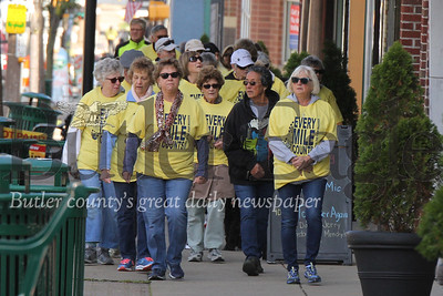 St. Vincent de Paul Friends of the Poor walkers walk down Main St. in Butler Saturday. Seb Foltz/Butler Eagle