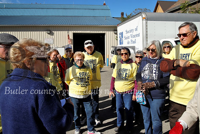 Walk For the Poor coordinator Paula Dorsch gives instructions for walkers Saturday at St. Vincent de Paul Food Bank in Butler. Seb Foltz/Butler Eagle