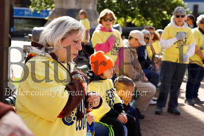Anita Theiss of Butler makes the sign of the cross following a silent prayer during the St. Vincent de Paul Friends of the Poor walk Saturday. Seb Foltz/Butler Eagle