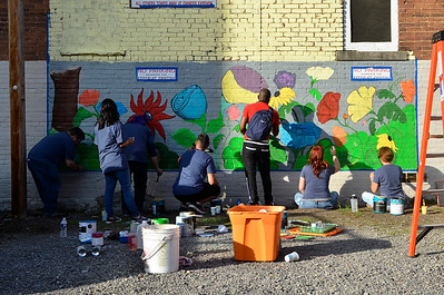 Butler's addiction recovery group Hope is Dope paints a mural on North Street on the side of Natili North Pizza Shoppe. The mural should be complete by mid-November. Tanner Cole/Butler Eagle