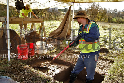 Mike Dietsch (right) and Steve Gatski dig and sift through dirt at an archaeological dig along the proposed reroute of the route 228 between route 8 and Mars High School. The archeological survey was contracted by PennDot as part of the project. Seb Foltz/Butler Eagle