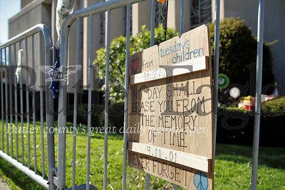 A remembrance sign from Tuesday's Children, a charity group for kids who wave survived traumatic events, hangs on the fence out side the Tree of Life synagogue in Squirrel Hill. Seb Foltz/Butler Eagle