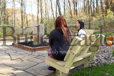 Heather Truchan(right),  clinical lead of women's programs at the Ellen O'Brien Gaiser Addiction Center in Butler, sits and talks with a patient in the Center's new garden space. Editor's note: patient pictured is not Rebecca from the news story. Seb Foltz/Butler Eagle
