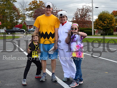 Owen, Mike, Christine and Kendal FitzGerald (cap g ok) pose before participating in the one-mile fun run Sunday at the 10th Annual Great Pumpkin Run in Zelienople. Alex J. Weidenhof/Butler Eagle