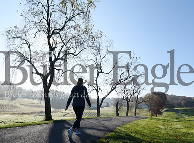 Harold Aughton/Butler Eagle: Kim Palmieri takes a brisk walk Monday moring in Cranberry Twp. Community Park.