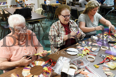 Harold Aughton/Butler Eagle: (left - right) Jakie, 80 of Chicora; Lucille Karenbauer, 78 of East Butler, and Kristina Funkhouser, manager of the Chicora Senior Center, work together on an arts and crafts project.