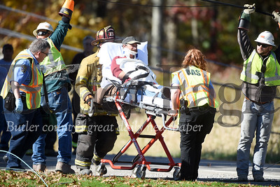 Harold Aughton/Butler Eagle: Emergency and utility workers were called to the scene of an accident at 892 Eakerstown Road, Monday. According to PSP Trooper Sheppeck, the driver of a white, 2-door pickup truck was traveling west on Eakerstown Road, Monday, Oct. 28 when the driver lost control of his vehicle striking a utlilty pole.  It took emergency workers more than an hour to reach the driver. The driver walked out of the truck on his own power. According to the Trooper Sheppeck, the driver was only wearing the lap strap of this seatbelt and hit his head on the windshield. Rescue personnel from the Butler Ambulance Service transported the driver to the hospital with non-life threatening injuries.
