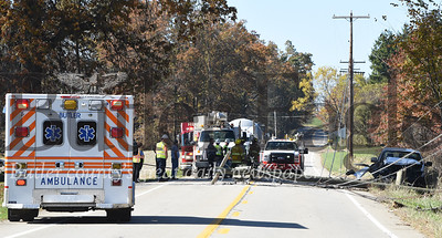 Harold Aughton/Butler Eagle: According to PSP Trooper Sheppeck, the driver of a white, 2-door pickup truck was traveling west on Ekastown Road, Monday, Oct. 28 when the driver lost control of his vehicle striking a utility pole.  It took emergency workers more than an hour to reach the driver as utility workers had to shut down power before removing wires from the vehicle. The driver walked out of the truck on his own power. According to the Trooper Sheppeck, the driver was only wearing the lap strap of this seatbelt and hit his head on the windshield. Rescue personnel from the Butler Ambulance Service transported the driver to the hospital with non-life threatening injuries.