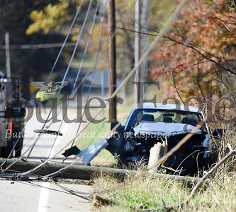 Harold Aughton/Butler Eagle:  According to PSP Trooper Sheppeck, the driver of a white, 2-door pickup truck was traveling west on Eakerstown Road, Monday, Oct. 28 when the driver lost control of his vehicle striking a utility pole.  It took emergency workers more than an hour to reach the driver as utility workers had to shut down power before removing wires from the vehicle. The driver walked out of the truck on his own power. According to the Trooper Sheppeck, the driver was only wearing the lap strap of this seatbelt and hit his head on the windshield. Rescue personnel from the Butler Ambulance Service transported the driver to the hospital with non-life threatening injuries.