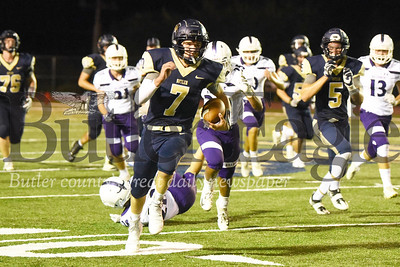 Butler quarterback Cooper Baxter sheds a would-be-tackle to break a 61-yard touchdown run in the fourth quarter of the team's 42-21 home loss Friday night. Seb Foltz/Butler Eagle