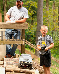 Chad Richter of Sarver watches his son Garrett, 7, steer his remote control Jeep on the RC course at Yogie Bear's Jellystone Park at Kozy Rest in Harrisville. Seb Foltz/Butler Eagle