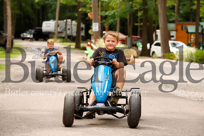 Jeffrey Ashton, 7, and Zane Haynes, 7, pedal through Yogi Bear's Jellystone Park at Kozy Rest. Seb Foltz/Butler Eagle