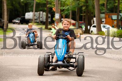 Jeffrey Ashton, 7, and Zane Haynes, 7, pedal through Yogi Bear's Jellystone Park at Kozy Rest. Seb Foltz/Butler Eagle