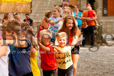 """Kids conga their way through bubbles during a dance party hosted by """"Bubble Lady"""" DJ Beth Ryder at Yogi Bear's Jellystone Park at Kozy Rest in Harrisville. Seb Foltz/Butler Eagle"""