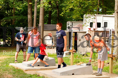 Guests compete on the cornhole court Yogi Bear's Jellystone Park at Kozy Rest over the weekend. Seb Foltz/Butler Eagle 083119