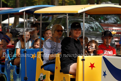 Kids and adults enjoy a train ride through Yogi Bear's Jellystone Park campground at Kozy Rest in Harrisville Saturday. Seb Foltz/Butler Eagle 083119
