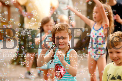 "Gracie Gaillot, 4, of Freeport dances through bubbles during a dance party hosted by ""Bubble Lady"" DJ Beth Ryder at Yogi Bear's Jellystone Park at Kozy Rest in Harrisville Saturday. Seb Foltz/Butler Eagle 083119"