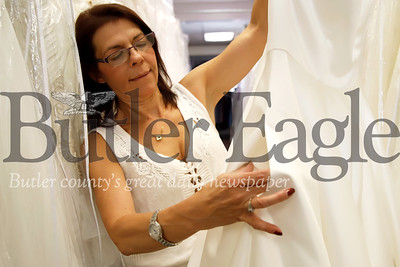 D.I. Bridal Boutique of Butler store manager Donna Wentley points out some subtle pockets sewn in to one of their wedding gowns. Wentley and store owner Cindy Ciccozzi said pockets are an increasingly sought after feature for dresses. Seb Foltz/Butler Eagle