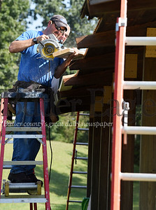 Harold Aughton/Butler Eagle: Carpenter Ben Fallecker of Butler County Facilities and Operations works with Carpenter Assistant Jerry Barnhart to replace the roof on shelter 14 in Alameda Park, Tuesday, Sept. 3.  This was the crews' third roof replacement in the park this year, requiring 21 sq. ft. of shingles.