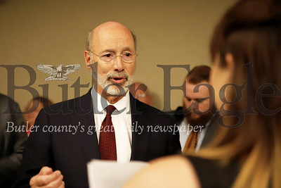 Governer Tom Wolf responds to a question from Slippery Rock University reporter Allison Downs at a news conference Wednesday following a round table discussion on sexual violence issues on college campuses. Seb Foltz/Butler Eagle