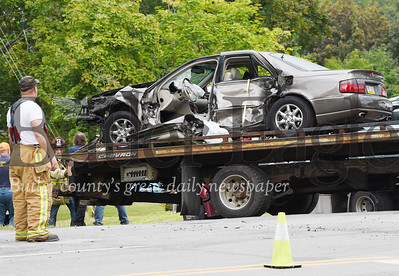 Harold Aughton/Butler Eagle: Emergency responders remove a car from a 3-car wreck at the instersection of Route 8 and Airport Road, Wednesday, Sept. 4.
